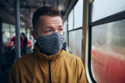 man wearing face mask in public transportation themes social distancing and personal protection t20 e9NmLa